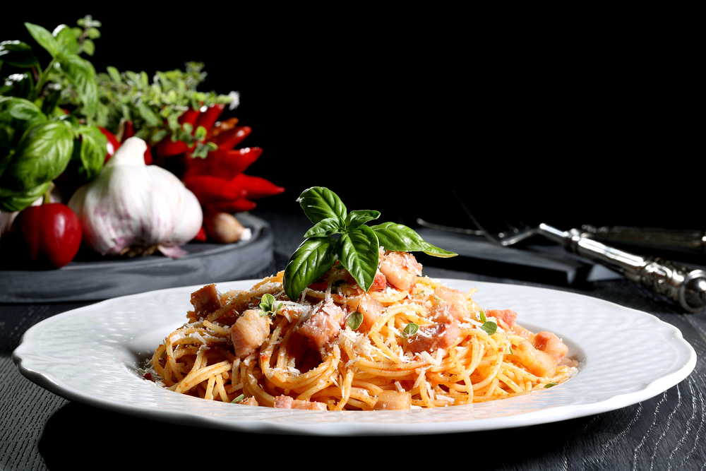 italian pasta amatriciana black background