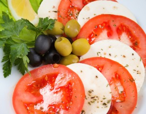 Mozzarella tomatoes olives Italian summer food