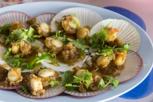 Grilled scallop with sauce in shell