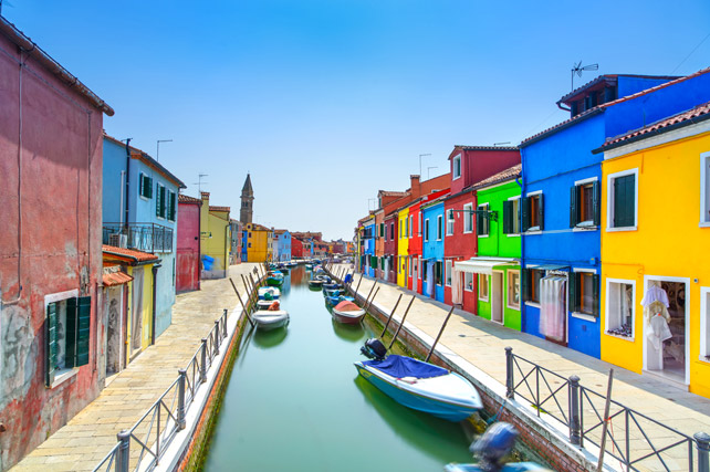 burano venice italy - canal colorful houses and boats