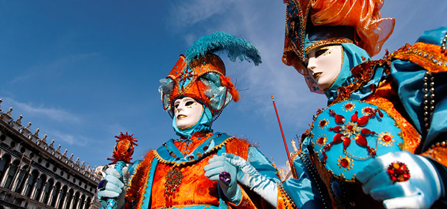 carnevale venice italy - revelers in costumes and masks