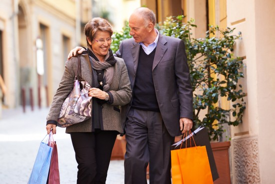Senior Old Man And Woman Shopping In Italy