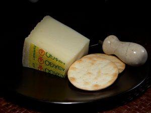 Slice of Asiago cheese