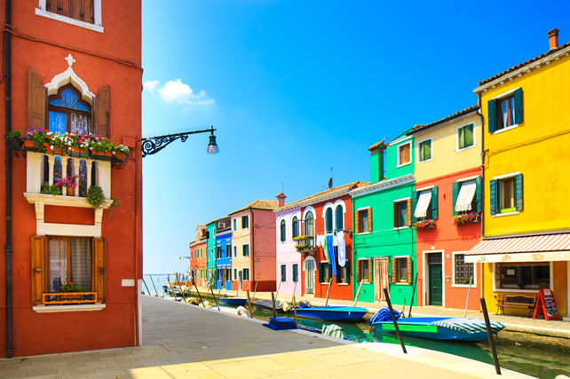 burano venice italy - island canal and colorful houses