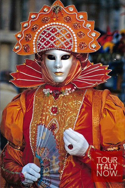 carnevale venice italy - orange mask and costume