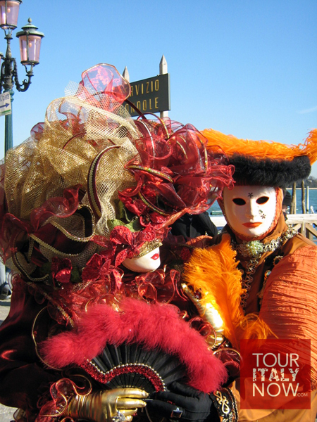 carnevale venice italy - revelers in costume and mask