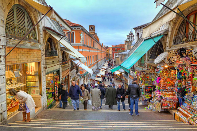 Ponte di Rialto Bridge Venice Italy - tourists and shops