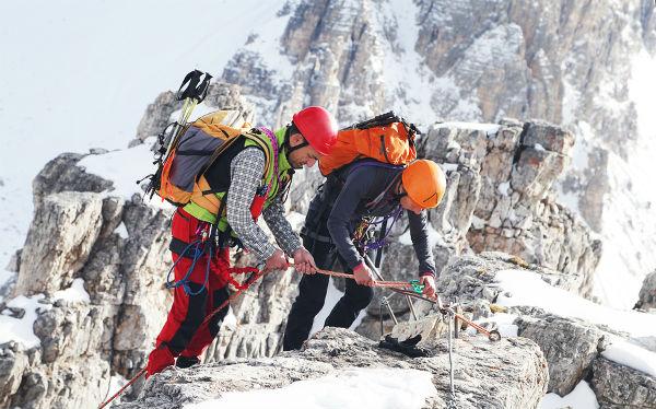 Alpinist-climbing-ferrata