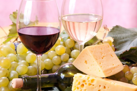 Bottle, cheese and glasses of wine