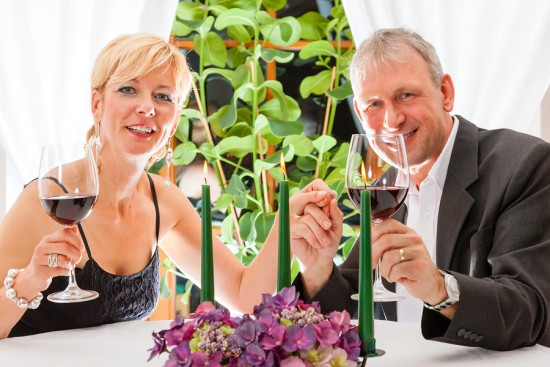 Senior couple having dinner in a restaurant, candles on the tabl
