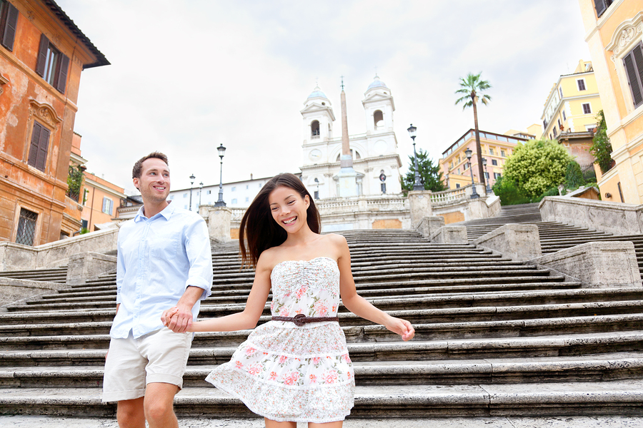 Happy romantic couple holding hands on Spanish Steps in Rome, It
