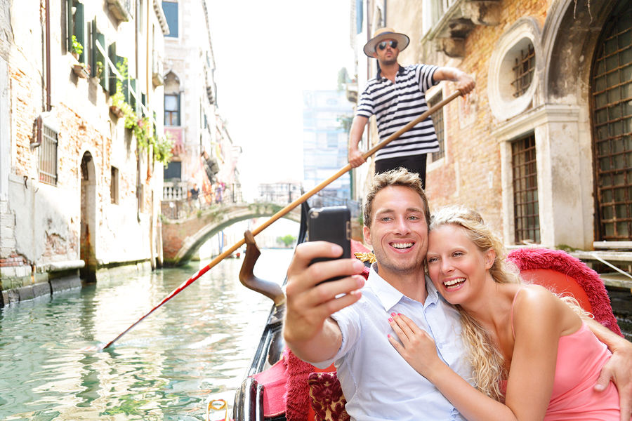 Couple in Venice on Gondole ride romance in boat happy together