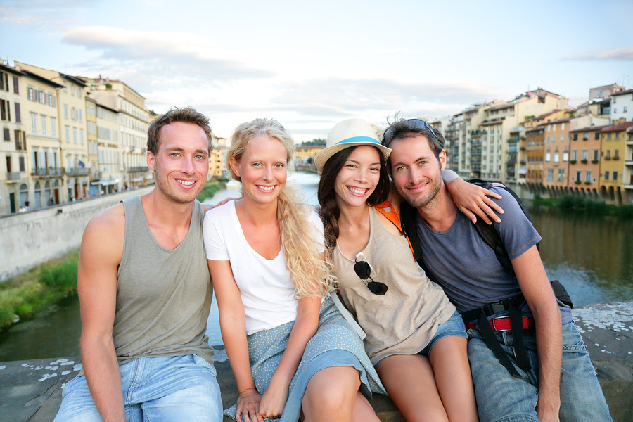 Friends - group of people on travel vacation having fun together